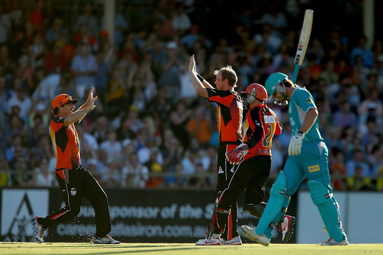 PERTH, AUSTRALIA - JANUARY 19: Brad Hogg and Michael Beer celebrate the wicket of Joe Burns of the Heat during the Big Bash League final match between the Perth Scorchers and the Brisbane Heat at the WACA on January 19, 2013 in Perth, Australia.  (Photo by Paul Kane/Getty Images)