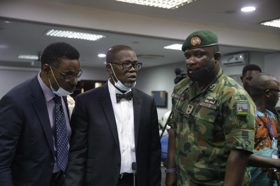 In this photo taken on Saturday Nov. 14, 2020. Brig. Gen. Ahmed Taiwo, Commander of the 81 Military Intelligence Brigade, right, speaks with lawyers before a judicial committee, in Lagos Nigeria. Nigeria's army has said after weeks of denial that its troop did fire shots into the air to disperse a large crowd at the Lekki Toll Plaza in Lagos where several peaceful protesters were killed late in October. (AP Photo/Sunday Alamba)