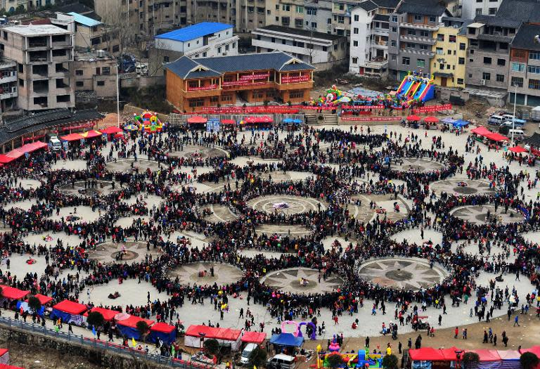People celebrate the Reed Pipe Festival of the Miao ethnic group, in Zhouxi township, Kaili, southwest China's Guizhou province, on February 19, 2014