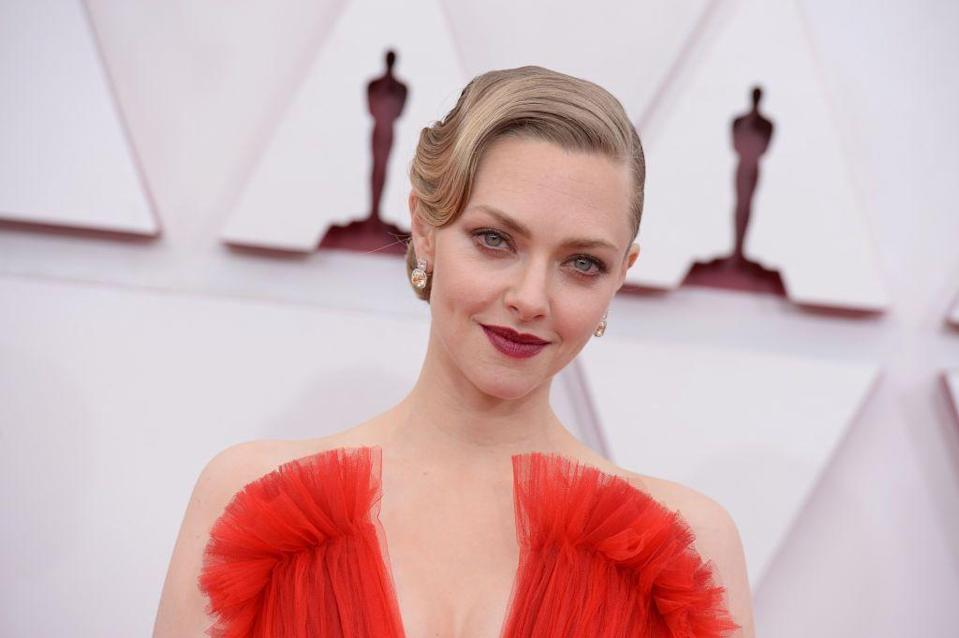 <p>A tonal red lip was the perfect finishing touch for Seyfried's Giorgio Armani Privé gown, while her waved hair was a nod to classic awards glamour. </p>