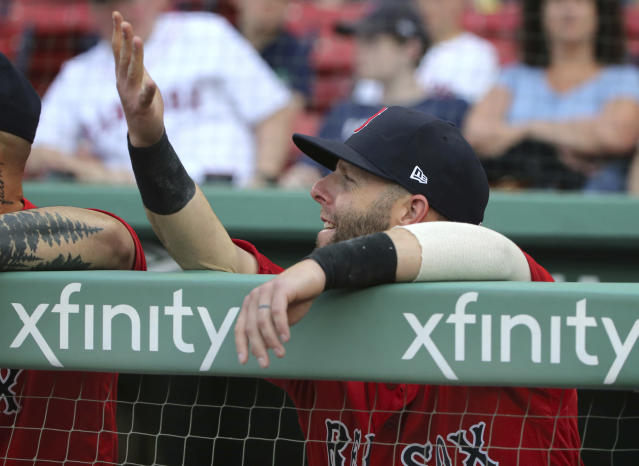 Boston Red Sox second baseman Dustin Pedroia gestures in the dugout before an interaleague baseball game against the Atlanta Braves at Fenway Park, Friday, May 25, 2018, in Boston. Pedroia is making his return after recovering from an injury. (AP Photo/Elise Amendola)