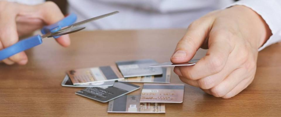 Image of scissors and cut credit cards.