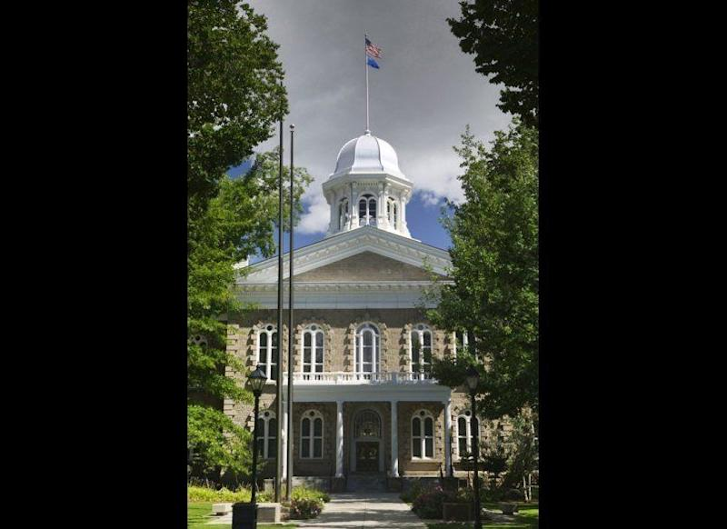 """<strong>NEVADA STATE CAPITOL</strong> Carson City, Nevada <strong>Year completed: </strong>1871 <strong>Architectural style:</strong> Neo-Classical Italianate <strong>FYI:</strong> After Nevada became a state, the constitutional convention made a provision that no state capitol would be built until after three legislative sessions, in case future leaders wanted to move the center of government away from Carson City. A ten-acre site set aside for the building remained empty. In his book Roughing It, Mark Twain describes the empty plaza as a useful spot for """"public auctions, horse trades, mass meetings, and likewise for teamsters to camp in."""" <strong>Visit:</strong> The capitol is open Monday to Friday, from 8 a.m. to 5 p.m. (it is closed on weekends). Call the Education Program at the Nevada State Museum to arrange guided tours."""