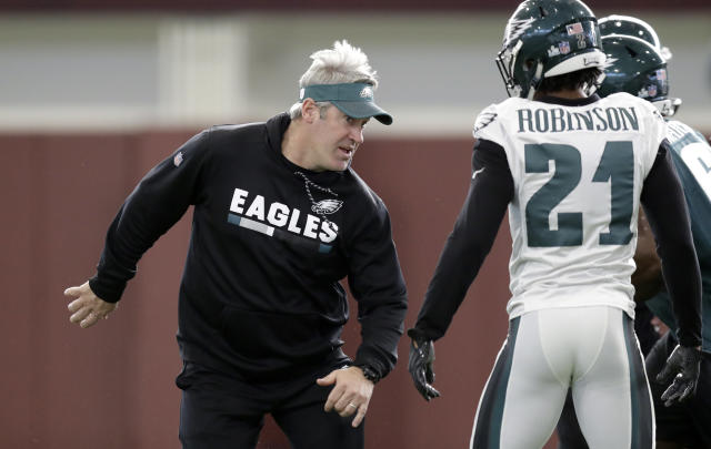 Philadelphia Eagles head coach Doug Pederson, left, works with his players during practice on Thursday. (AP)