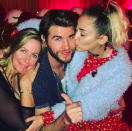 """<p>The actor's mother, Leonie Hemsworth, also joined in the fun. The actress got a kiss from Miley while his mom rested her head on his shoulder. """"Whatever,"""" he wrote. (Photo: <a rel=""""nofollow noopener"""" href=""""https://www.instagram.com/p/BOeW9mcjEK-/?taken-by=liamhemsworth&hl=en"""" target=""""_blank"""" data-ylk=""""slk:Instagram"""" class=""""link rapid-noclick-resp"""">Instagram</a>) </p>"""
