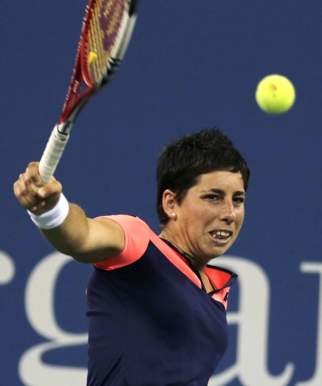 Carla Suarez Navarro, of Spain, returns to Serena Williams, of the United States, during a women's quarterfinal at the U.S. Open tennis tournament, Tuesday, Sept. 3, 2013, in New York. Williams won 6-0, 6-0. (AP Photo/Charles Krupa)