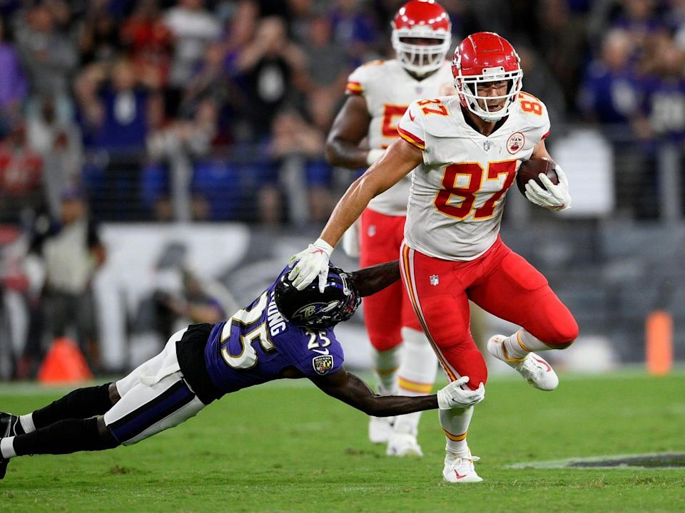 Travis Kelce makes a play against the Baltimore Ravens.