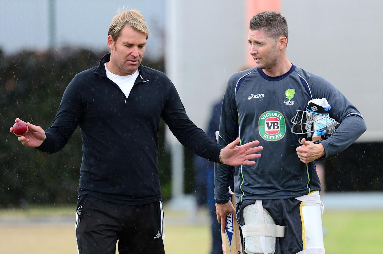 Australia captain Michael Clarke talks with Shane Warne during the nets session at Old Trafford Cricket Ground, Manchester.