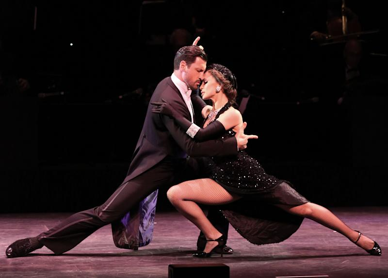 """In this July 11, 2013 photo released by The O + M Company, Maksim Chmerkovskiy, left, and Karina Smirnoff perform during """"Forever Tango"""" at the Walter Kerr Theatre in New York. (AP Photo/The O + M Company, Walter McBride)"""