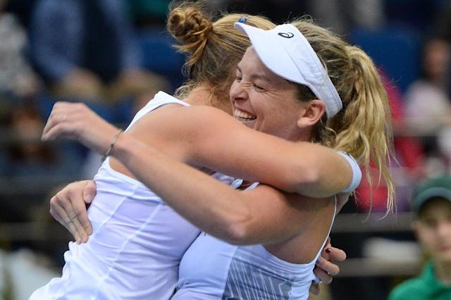 USA's Shelby Rogers (L) and Coco Vandeweghe celebrate their victory over Belarus' Aliaksandra Sasnovich and Aryna Sabalenka at the end of their match aas part of the Fed Cup final tennis match between Belarus and the United States (AFP Photo/MAXIM MALINOVSKY)