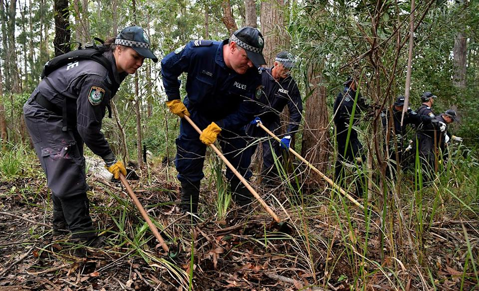 <span>Members of the NSW Public Order and Riot Squad clear bushland in Kendall on the NSW mid-north coast earlier this month. Source: AAP</span>