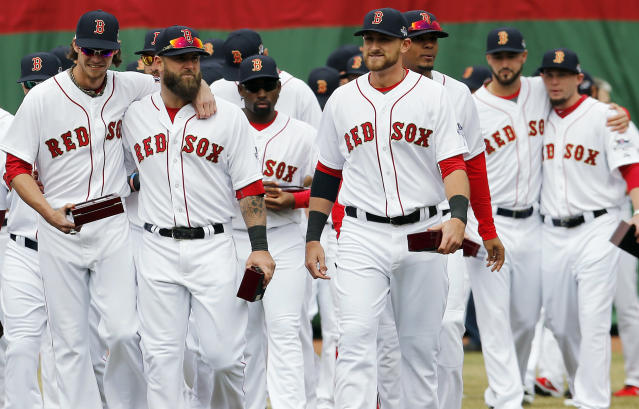 Boston Red Sox players walk on the field after receiving their World Series rings during pre-game ceremonies before a baseball game between the Red Sox and the Milwaukee Brewers on opening day at Fenway Park in Boston, Friday, April 4, 2014. (AP Photo/Michael Dwyer)