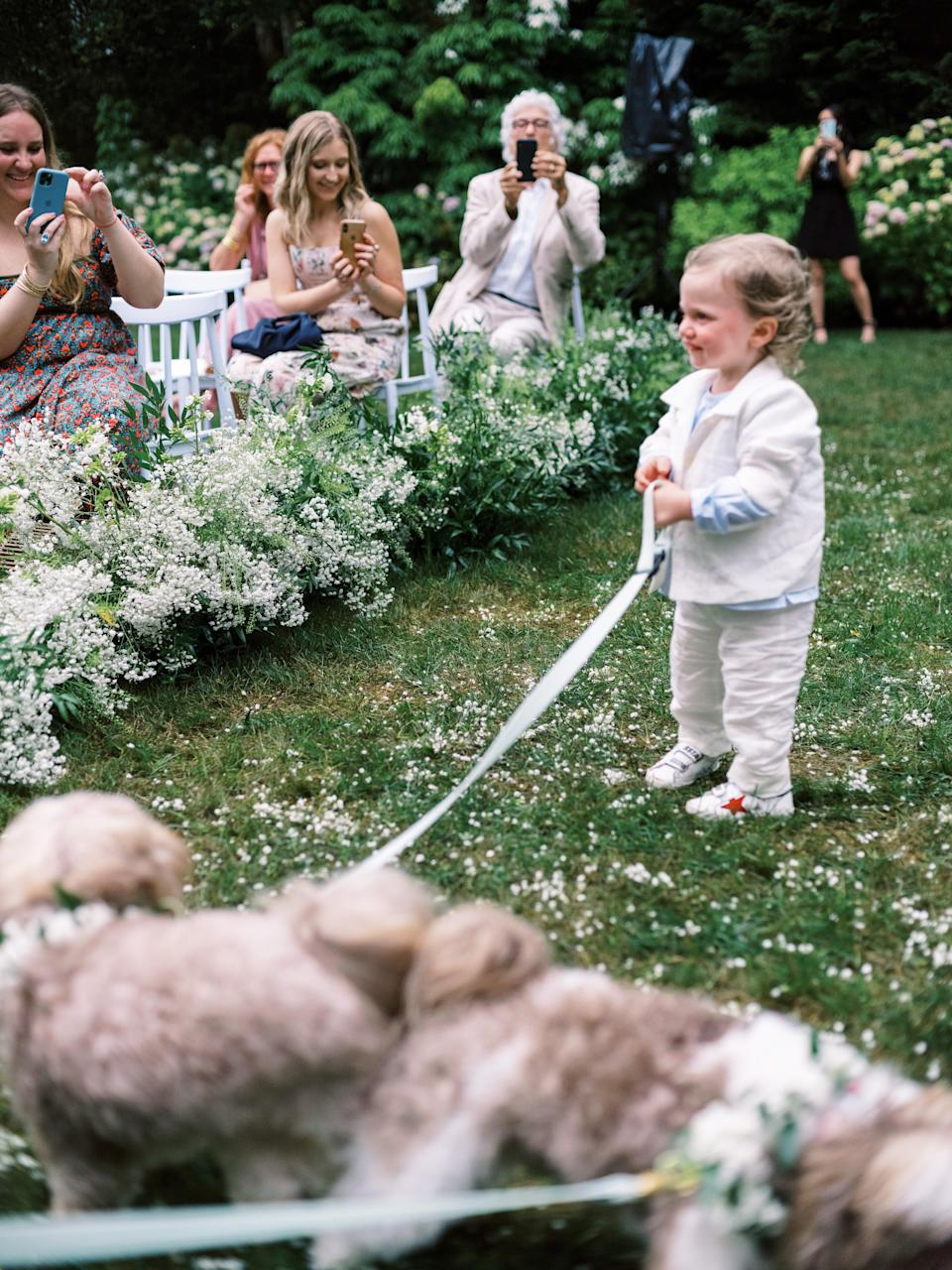 We had our nephews walk our dogs, Honey and Hershey, down the aisle. My sister's son, Bear, wasn't even 2 years old yet. He's such a little rock star! Jung made Honey and Hershey the cutest little floral collars to wear down the aisle.