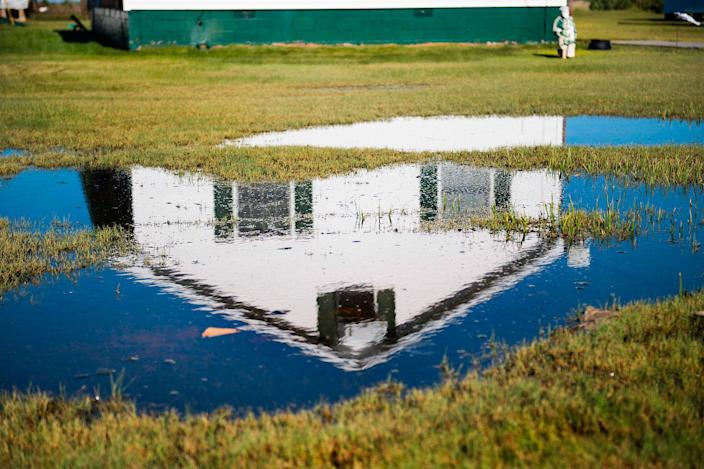 <p>Swamp grass and standing water take over the front yard of a home in Tangier, Virginia, May 15, 2017, where climate change and rising sea levels threaten the inhabitants of the slowly sinking island.<br> (Jim Watson/AFP/Getty Images) </p>