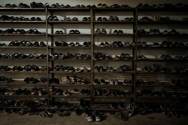 Shoes of students are placed at the entrance of the dining hall of the Khatamul Anbiya madrasa in Kabul, Afghanistan, Tuesday, Sept. 28, 2021. (AP Photo/Felipe Dana) (Photo: via Associated Press)