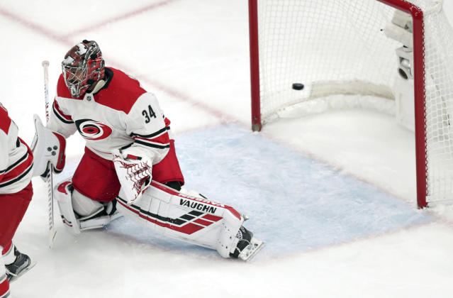 Carolina Hurricanes goaltender Petr Mrazek (34), of the Czech Republic, drops to a knee as a shot by Boston Bruins' Steven Kampfer goes past for a goal during the first period in Game 1 of the NHL hockey Stanley Cup Eastern Conference finals Thursday, May 9, 2019, in Boston. (AP Photo/Charles Krupa)