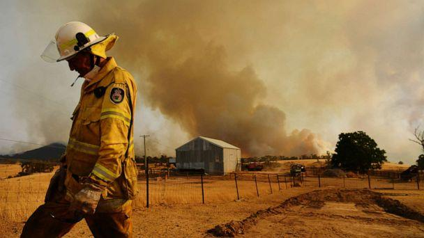 PHOTO: A Rural Fire Service firefighter views the flank of a fire, Jan. 11, 2020, in Tumburumba, Australia.<p>(Sam Mooy/Getty Images)
