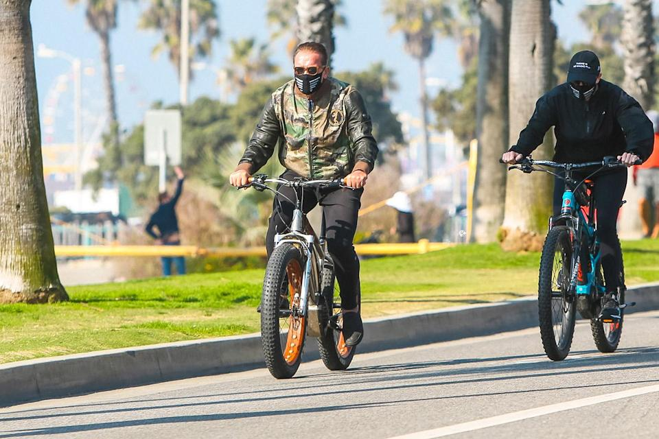 <p>Arnold Schwarzenegger takes a bike ride in L.A. on Friday wearing a camo jacket. </p>