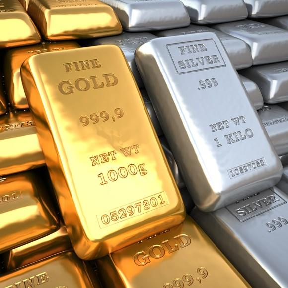Gold and silver bars sacked against each other.