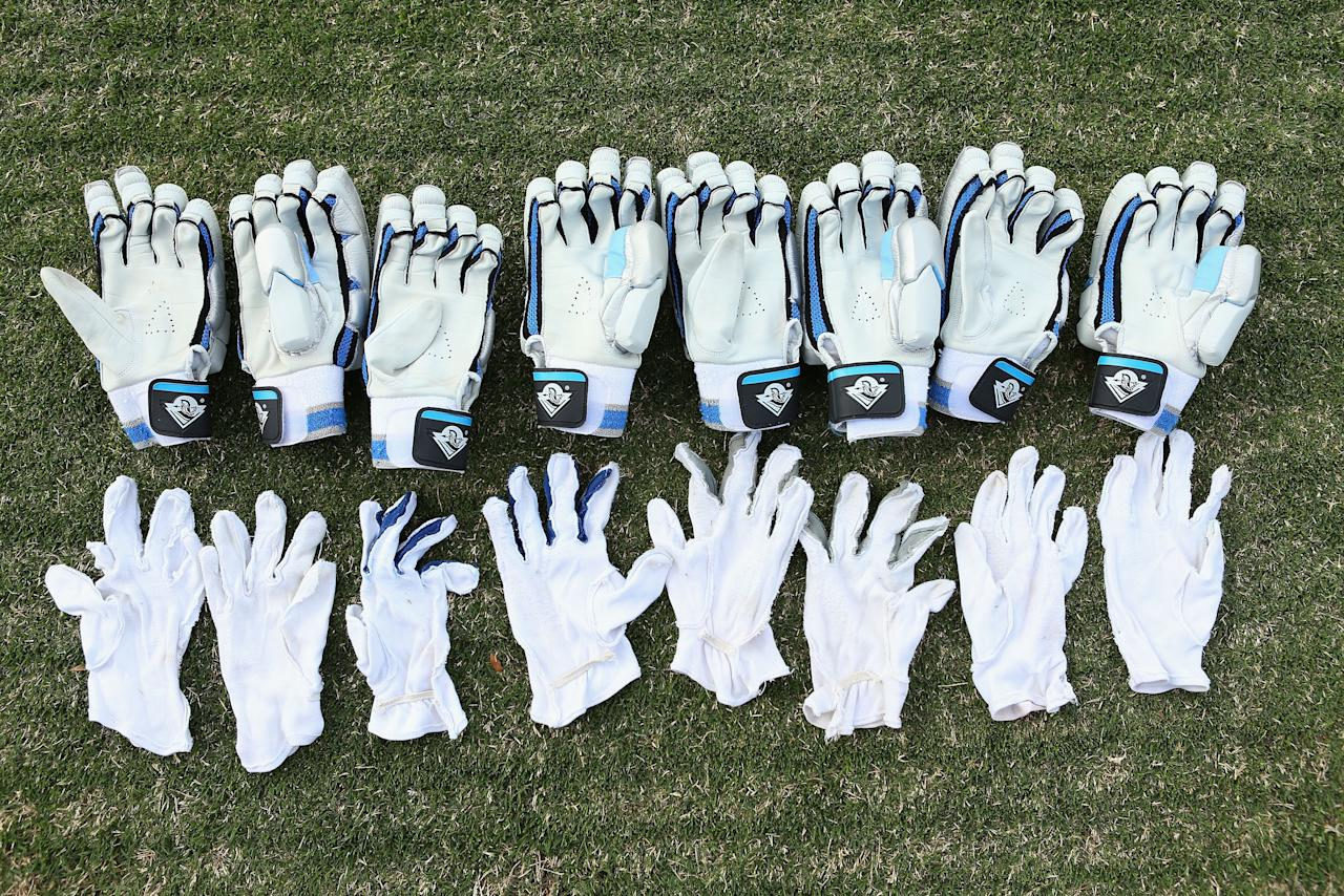 SYDNEY, AUSTRALIA - SEPTEMBER 26:  New South Wales players batting gloves are aired during day one of the Sheffield Shield mmatch between the New South Wales Blues and the Tasmanian Tigers at Bankstown Oval on September 26, 2012 in Sydney, Australia.  (Photo by Cameron Spencer/Getty Images)