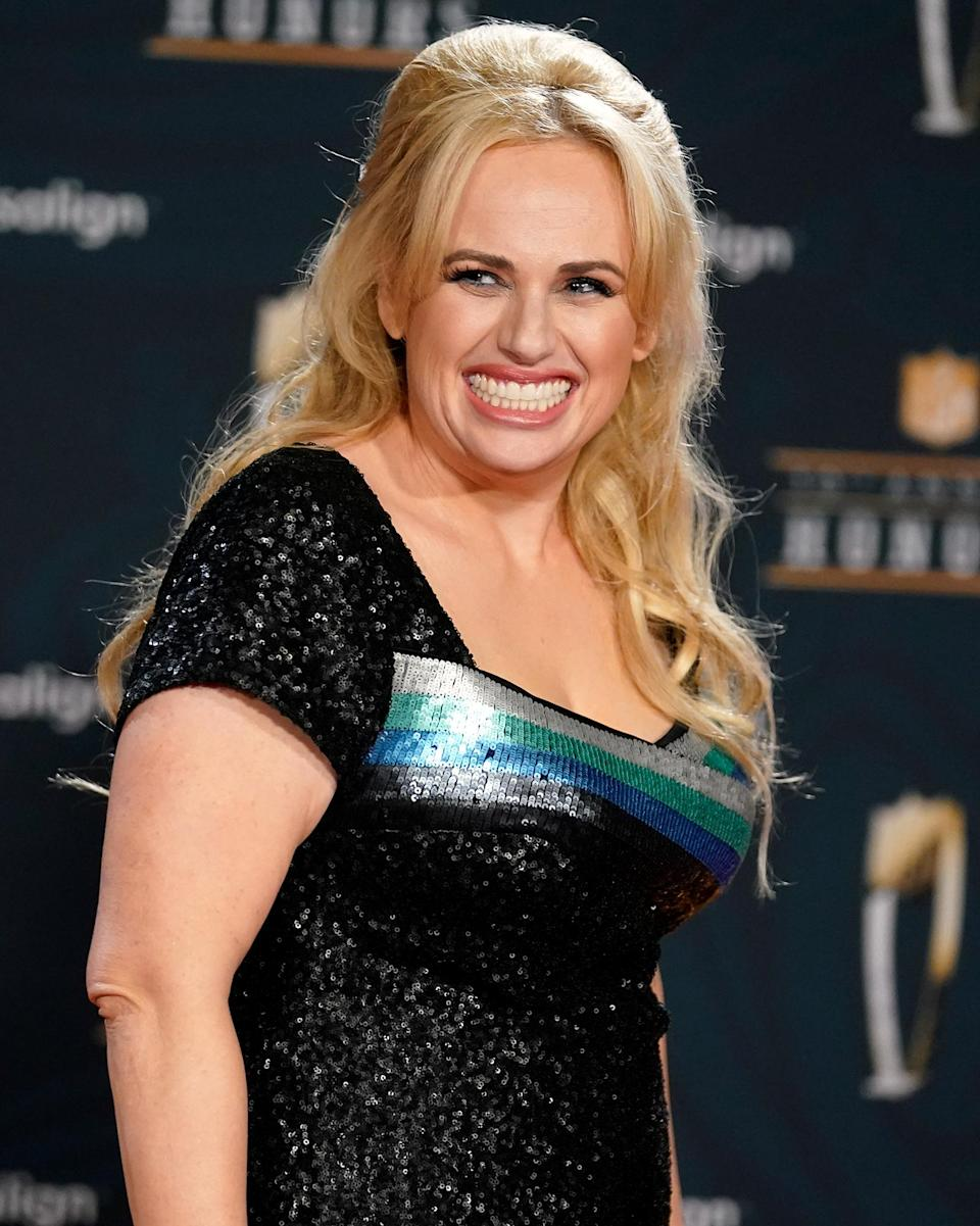 <p>Rebel Wilson is in great spirits on the red carpet during the NFL Honors Football Awards show on Tuesday in L.A.</p>
