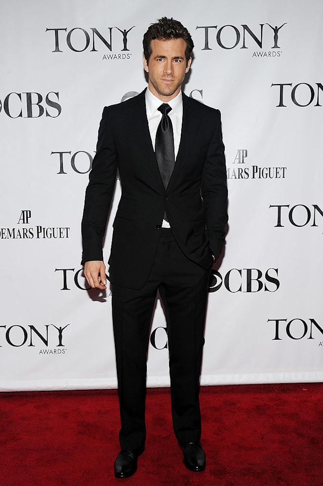 """Right behind ScarJo was her hunk of a husband, Ryan Reynolds, who kept it simple yet super sexy in a black suit. Bryan Bedder/<a href=""""http://www.gettyimages.com/"""" target=""""new"""">GettyImages.com</a> - June 13, 2010"""