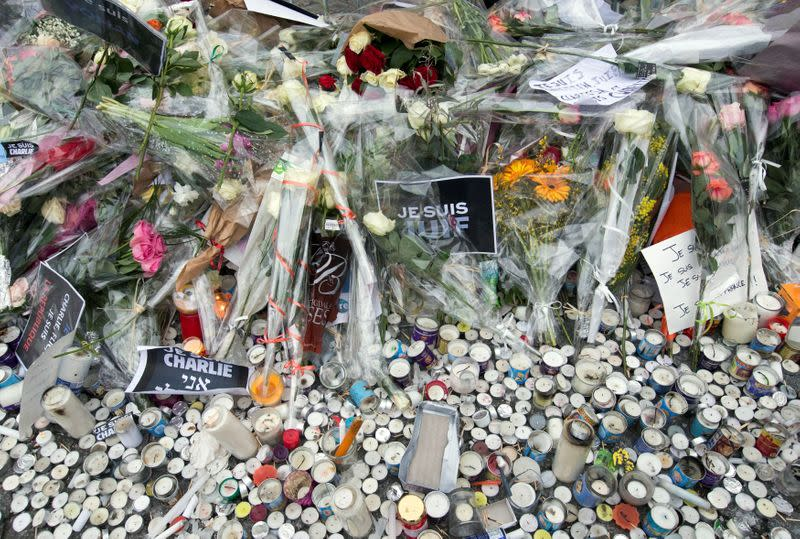 FILE PHOTO: Flowers are placed at the Hyper Cacher kosher supermarket near Porte de Vincennes in eastern Paris