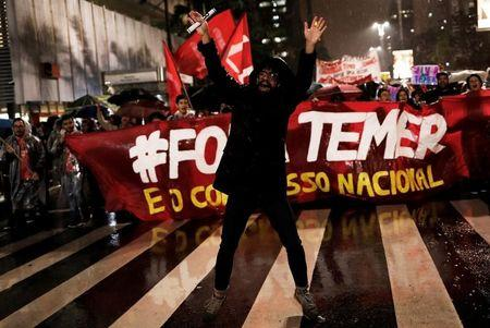 "Demonstrators take part in a protest against Brazil's President Michel Temer in Sao Paulo, Brazil, May 18, 2017. The banner reads ""Out Temer."" REUTERS/Nacho Doce"