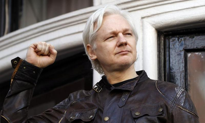 Julian Assange with a raised fist