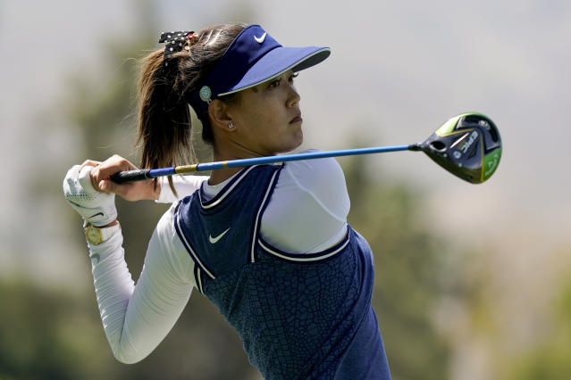 FILE - In this April 5, 2019, file photo, Michelle Wie watches her tee shot on the 118th hole during the second round of the LPGA Tour ANA Inspiration golf tournament at Mission Hills Country Club in Rancho Mirage, Calif. Wie is among additions to the CBS golf broadcast team. (AP Photo/Chris Carlson, File)