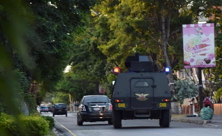 A National Guard armored truck drives on the streets of Cumana, Venezuela, on June 16, 2016 (AFP Photo/Manuel Trujillo)