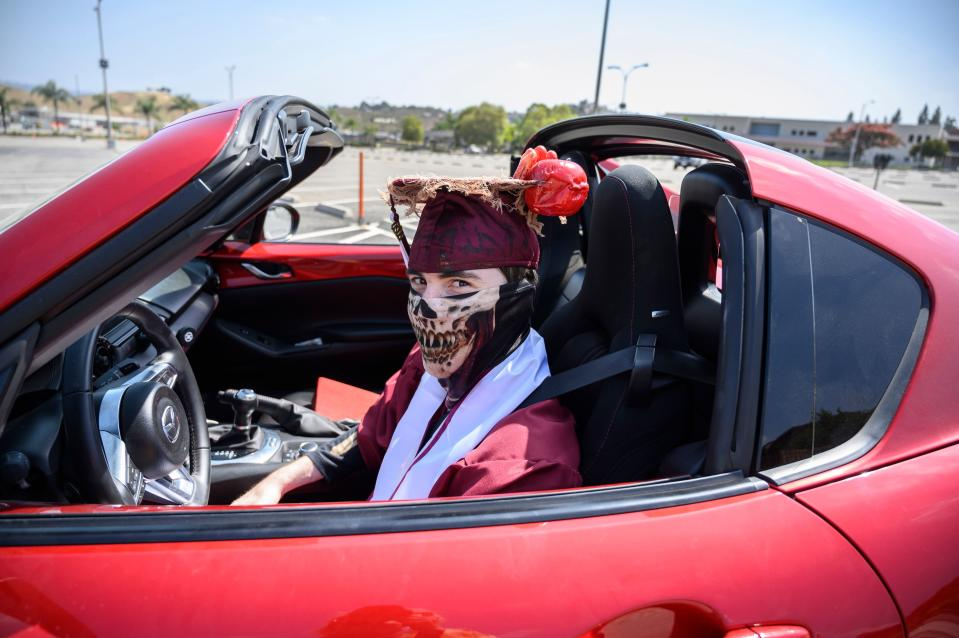 Mount San Antonio College graduating student Scott Macias arrives to receive his diploma from his car window at the school's first drive-thru commencement ceremony, June 18, 2020 in Walnut, California. (Photo: ROBYN BECK/AFP via Getty Images)