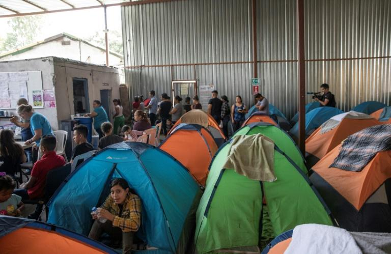 People live in tents in the crowded Juventud 2000 migrant shelter in Tijuana, Mexico (AFP Photo/Eduardo Jaramillo Castro)