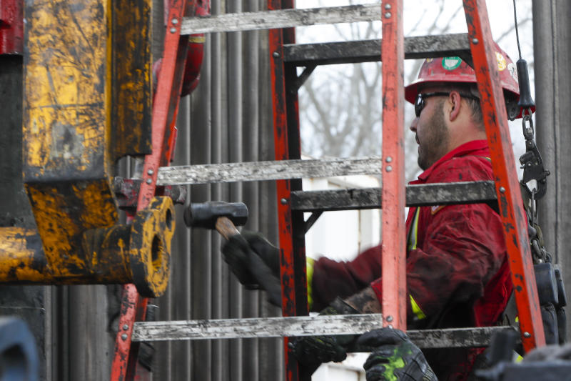 In this photo made on Thursday, March 12, 2020, workers change the equipment on the drilling platform at a Seneca Resources shale gas well drilling site in St. Mary's, Pa. (AP Photo/Keith Srakocic)