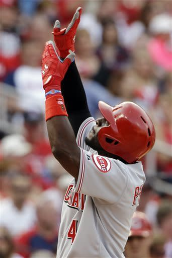 Cincinnati Reds' Brandon Phillips celebrates after hitting a solo home run during the sixth inning of a baseball game against the St. Louis Cardinals, Monday, April 8, 2013, in St. Louis. (AP Photo/Jeff Roberson)
