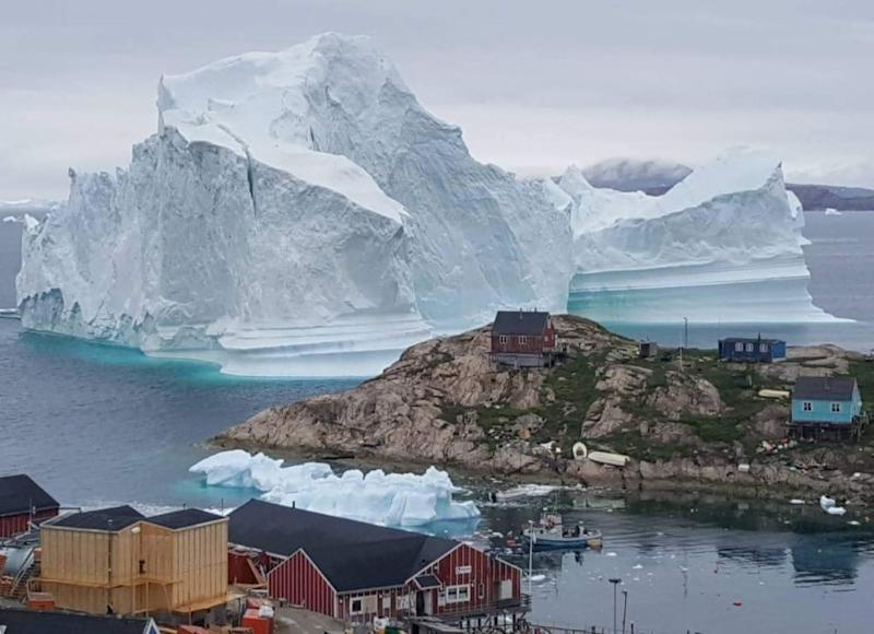 An iceberg is grounded outside the village of Innarsuit in northwestern Greenland
