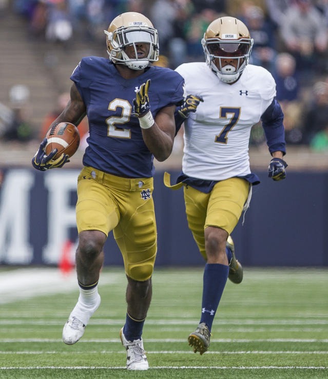 Notre Dame's Dexter Williams (2) runs the ball in front of Nick Watkins (7) during the Notre Dame Blue-Gold Spring college football game Saturday, April 21, 2018, inside Notre Dame Stadium in South Bend, Ind. (Robert Franklin/South Bend Tribune via AP)