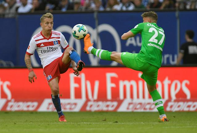 Soccer Football - Bundesliga - Hamburger SV v Borussia Moenchengladbach - Volksparkstadion, Hamburg, Germany - May 12, 2018 Hamburg's Lewis Holtby in action with Borussia Monchengladbach's Mickael Cuisance REUTERS/Fabian Bimmer DFL RULES TO LIMIT THE ONLINE USAGE DURING MATCH TIME TO 15 PICTURES PER GAME. IMAGE SEQUENCES TO SIMULATE VIDEO IS NOT ALLOWED AT ANY TIME. FOR FURTHER QUERIES PLEASE CONTACT DFL DIRECTLY AT + 49 69 650050