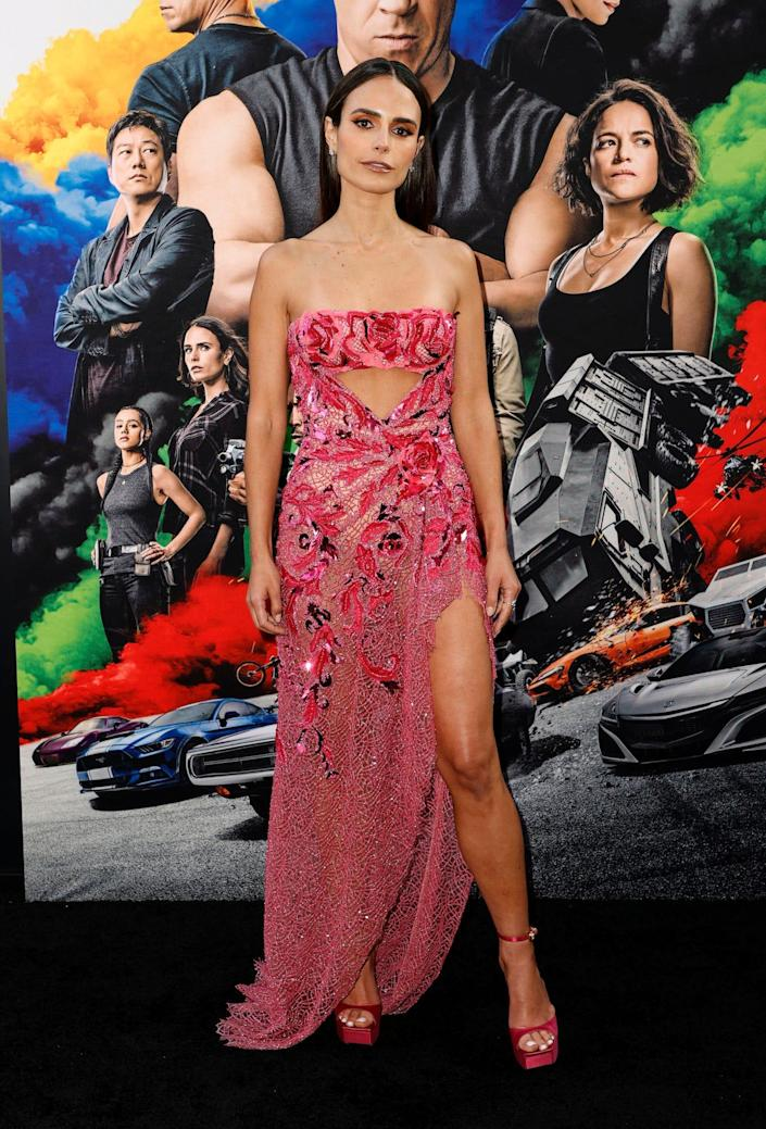 """Jordana Brewster wears a pink dress with a see-through skirt at the """"F9"""" premiere."""