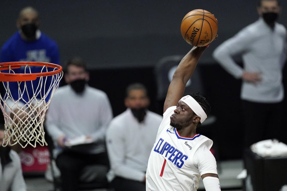 Los Angeles Clippers guard Reggie Jackson dunks during the first half of the team's NBA basketball game against the Washington Wizards on Tuesday, Feb. 23, 2021, in Los Angeles. (AP Photo/Mark J. Terrill)