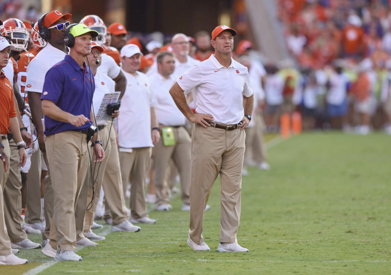 Clemson head coach Dabo Swinney, center, and defensive coach Brent Venables, left, watch the action during the second half against Texas A&M on Sept. 7, 2019. (AP)