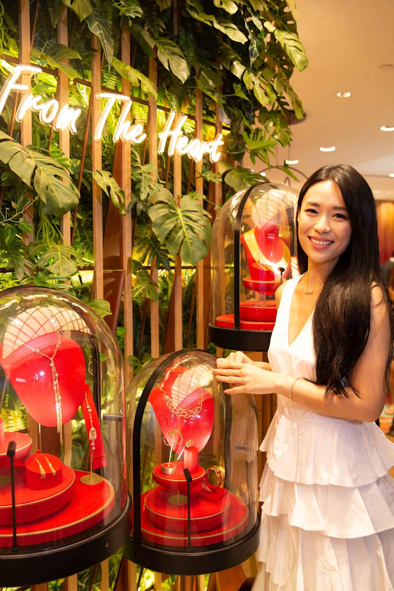 Rebecca Lim posing at the Library of Gold section in the store. (PHOTO: Goldheart)