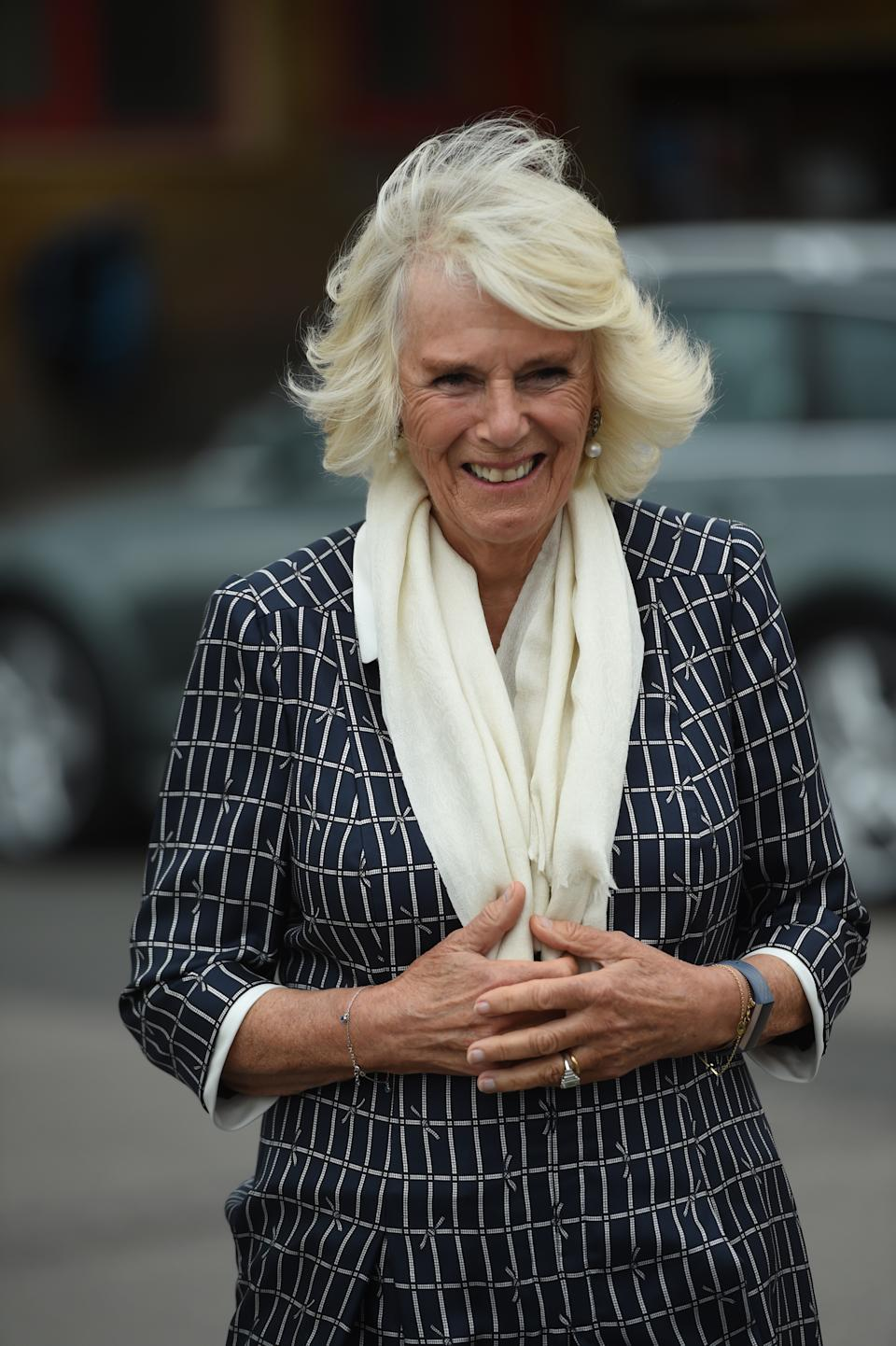 The Duchess of Cornwall meets firefighters, staff from Great Western Hospital and paramedics from South Western Ambulance Service during a visit to Swindon Fire Station in Wiltshire.
