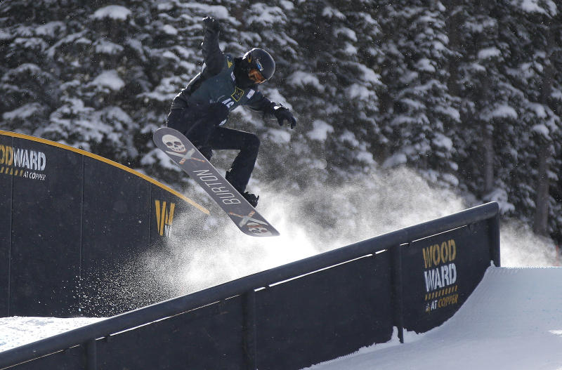 Shaun White slides off a rail during the U.S. Grand Prix slopestyle snowboarding finals, Sunday, Dec. 22, 2013, in Frisco, Colo. White finished third in the event. (AP Photo/Julie Jacobson)