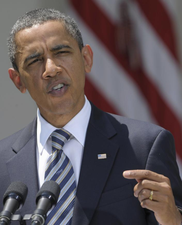 """The president has said of his changing hair color: """"Malia and Sasha say it makes me look distinguished. Michelle says it makes me look old."""" Here, he delivers a statement following the Senate's passing of the debt ceiling agreement on Aug. 2, 2011. (AP Photo/Susan Walsh)"""