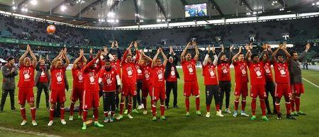 Bayern Munich's players celebrate after the match after winning the Bundesliga
