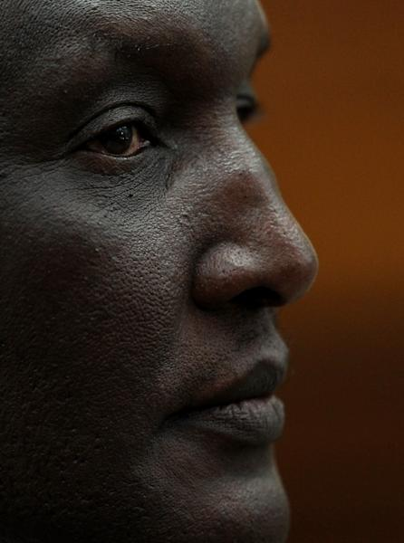Rwandan former Gen. Faustin Kayumba Nyamwasa looks on as he sits on the witness box at a court in Johannesburg, South Africa, Wednesday, June 20, 2012. Nyamwasa, a critic of his former boss Rwandan President Paul Kagame, took the stand as a witness Wednesday, making his first public appearance since he was shot and wounded in Johannesburg in 2010. (AP Photo/Themba Hadebe)