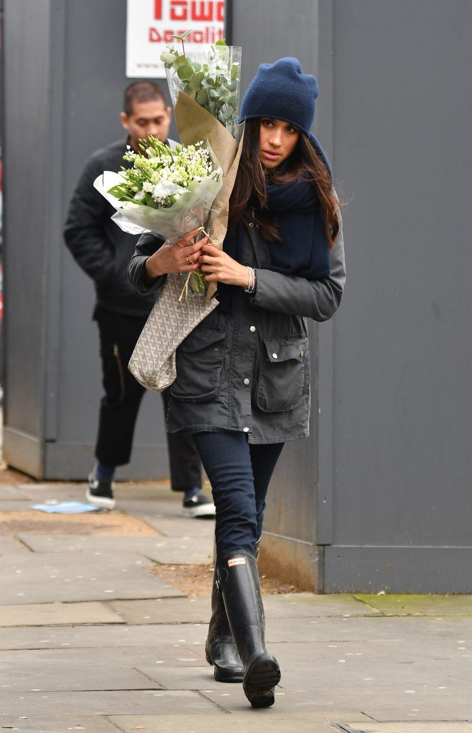 "<p>While shopping for flowers on Kensington High Street, Markle wears a Barbour jacket and Hunter wellingtons.</p><p><a class=""link rapid-noclick-resp"" href=""https://www.neimanmarcus.com/Hunter-Boot-Original-Tall-Gloss-Rain-Boot/prod195770226/p.prod"" rel=""nofollow noopener"" target=""_blank"" data-ylk=""slk:SHOP NOW"">SHOP NOW</a> <em>Hunter Boot Original Tall Gloss Rain Boot, $150</em><br></p>"