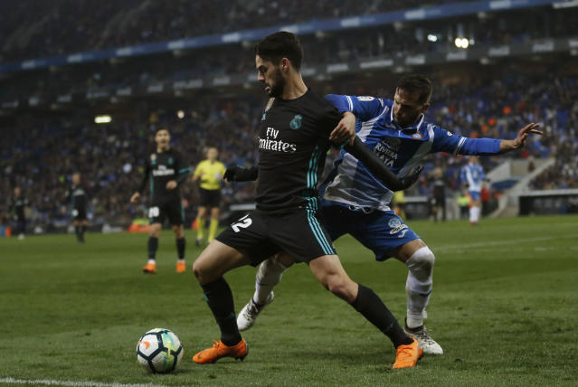 Real Madrid's Isco, left, duels for the ball against Espanyol's Pablo Patti during the Spanish La Liga soccer match between Espanyol and Real Madrid at RCDE stadium in Cornella Llobregat, Spain, Tuesday, Feb. 27, 2018. (AP Photo/Manu Fernandez)