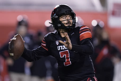 Utah quarterback Cameron Rising looks for a receiver during the first half of the team's NCAA college football game against Southern California on Saturday, Nov. 21, 2020, in Salt Lake City. (AP Photo/Rick Bowmer)